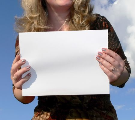Business woman holding a white card, space for writing