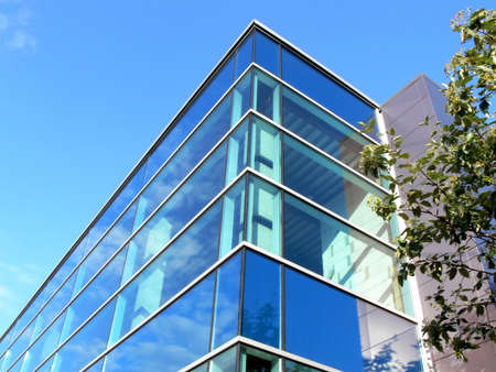 Modern office building with glass windows Stock Photo