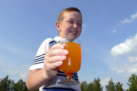 suggests: The boy suggests to be freshened by orange juice