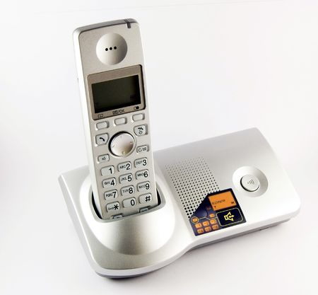 A newer model cordless phone lit up Stock Photo