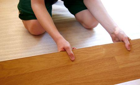redesign: Man making the laminate flooring installation