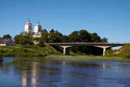 catolic: Lithuanian landscape with river, bridge and catolic church