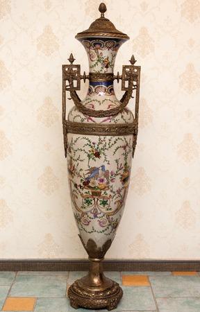 Vintage vase with bronze ornament
