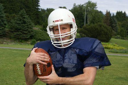 pigskin: shot of a american football player wearing a helmet