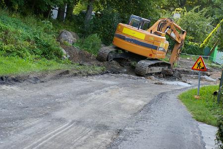 grader: road construction tractor excavator shovel grader          Stock Photo