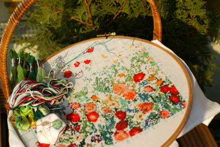 needlework of generic flowers on textile (cross stitch)