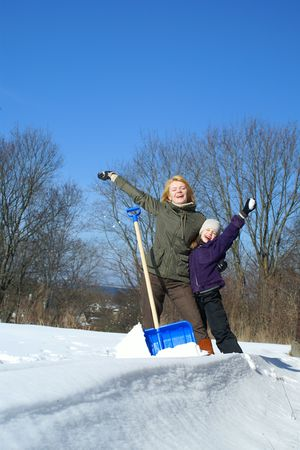mother and daughter shoveling and have fan outside Stock Photo - 2785173