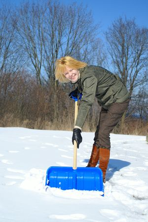 young woman shoveling after a snow storm Stock Photo - 2785172