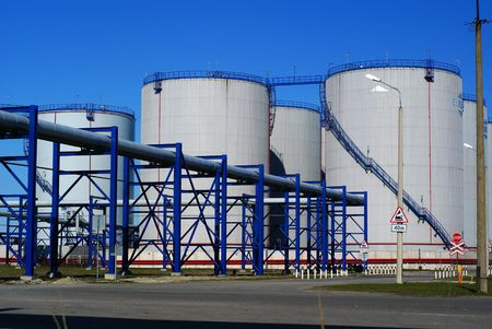 industrial pipelines and storage tanks against blue sky         Stock Photo - 2914743