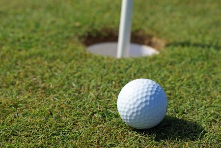 Golfball in front of the hole              Stock Photo - 2989190
