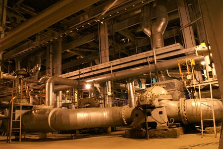 complex system: Pipes, machinery, tubes and pumps at a power plant            Stock Photo