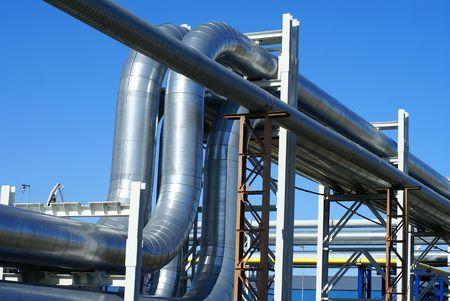 gas turbine: industrial pipelines on pipe-bridge against blue sky        Stock Photo