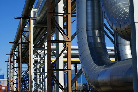 industrial pipelines on pipe-bridge against blue sky     photo