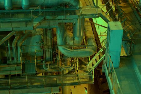 producing: Equipment, cables and piping as found inside of a modern industrial power plant