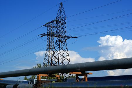 industrial pipelines on pipe-bridge and electric power lines  against blue sky Stock Photo - 3381065