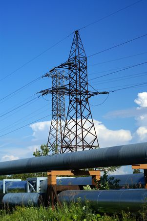 industrial pipelines on pipe-bridge and electric power lines  against blue sky             Stock Photo - 3381068