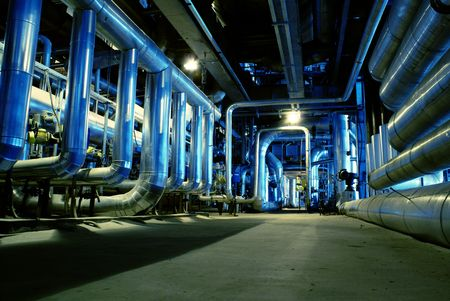 complex system: Pipes, tubes, machinery and steam turbine at a power plant                  Stock Photo