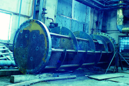 Equipment, cables and piping as found inside of a old industrial power plant      photo