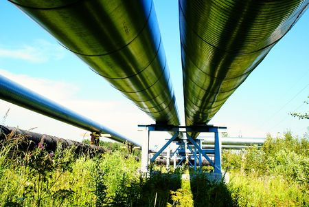 commerce and industry: industrial pipelines on pipe-bridge against blue sky
