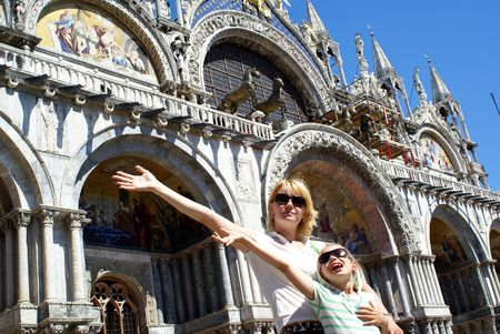 mother and daughter at venice, St. Marco square photo