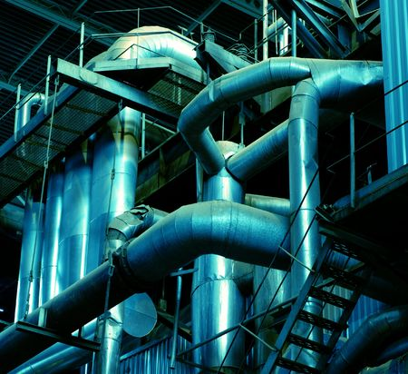 Pipes, tubes, machinery and steam turbine at a power plant      Stock Photo