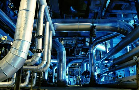 steam turbine: Pipes, tubes, machinery and steam turbine at a power plant                  Stock Photo