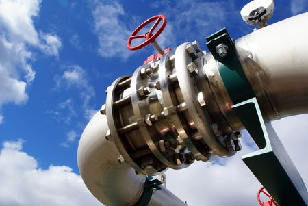 Pipes, boltss, valves against blue sky  photo