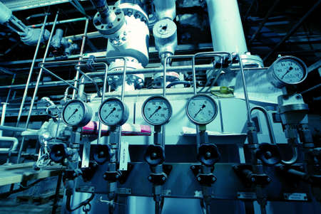 turbines: Pipes, tubes, machinery and steam turbine at a power plant