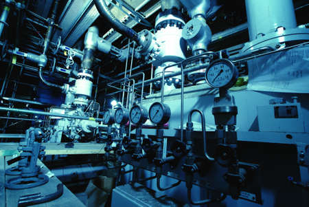 water treatment: Pressure gauges connected with many metallic pipes, interior of water treatment plant