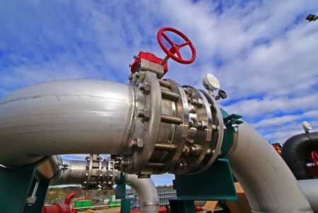 combustible: Pipes, bolts, valves against blue sky