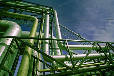 immense: industrial pipelines on pipe-bridge against blue sky