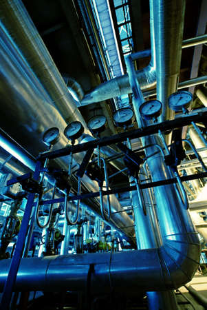 sewage treatment plant: Equipment, cables and piping as found inside of a industrial power plant            Stock Photo