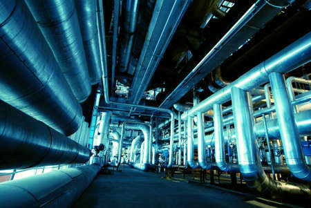 heavy industry: Pipes, tubes, machinery and steam turbine at a power plant             Stock Photo