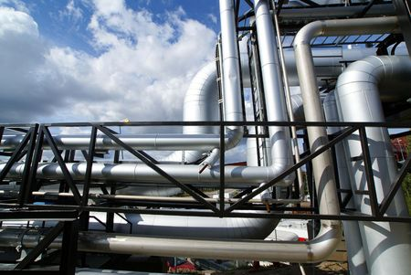 combustible: Pipes, bolts, valves against blue sky         Stock Photo