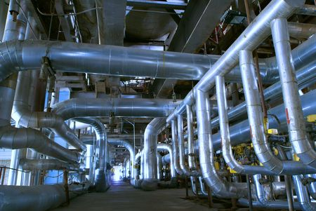 Pipes, tubes, machinery and steam turbine at a power plant                Stock Photo - 5740949