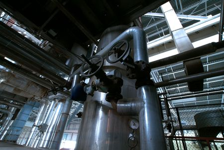 Equipment, cables and piping as found inside of a modern industrial power plant                    photo