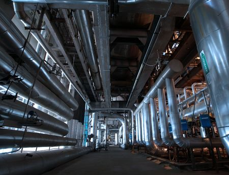 Pipes, tubes, machinery and steam turbine at a power plant Stock Photo - 6470595