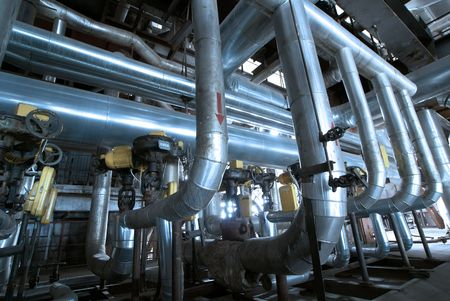 Pipes, tubes, machinery and steam turbine at a power plant               photo