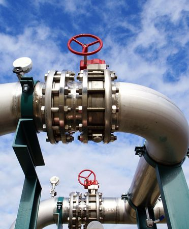 cloud industry: Industrial zone, Steel pipe-lines on blue sky                 Stock Photo