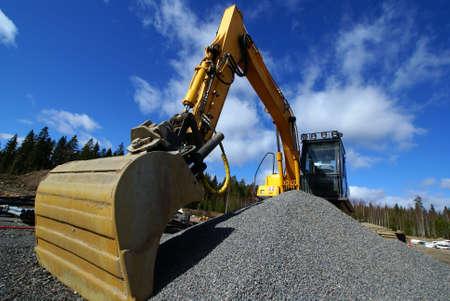 Hydraulic excavator at work. Shovel bucket against blue sky                  Stock Photo - 6970276