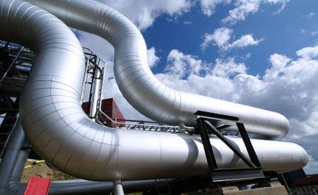 Industrial zone, Steel pipelines on blue sky                 photo