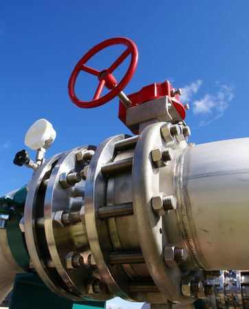 Industrial zone, Steel pipelines and valve on blue sky             photo