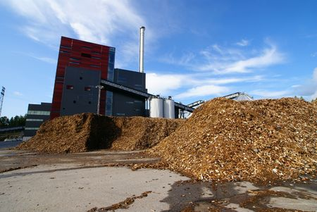 natural resources: bio power plant with storage of wooden fuel        Stock Photo