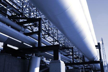 combustible: industrial pipelines on pipe-bridge against blue sky