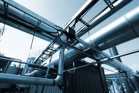 mineral oil: Industrial zone, Steel pipelines in blue tones   Stock Photo
