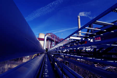 Industrial zone, Steel pipelines and valves against blue sky                Stock Photo - 8629381