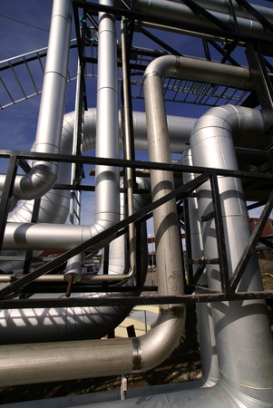 Industrial zone, Steel pipelines and valves against blue sky Stock Photo - 10707692