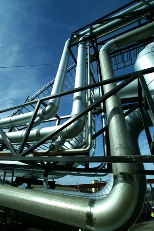 shinereflection: Industrial zone, Steel pipelines and valves against blue sky
