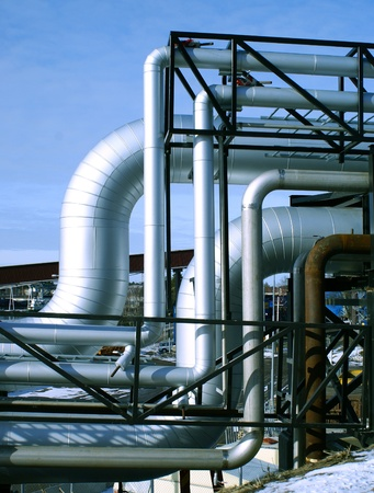 Industrial zone, Steel pipelines and valves against blue sky Stock Photo - 10707682