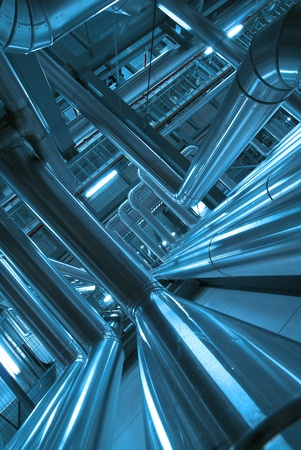 mechanical engineering: Equipment, cables and piping as found inside of  industrial power plant
